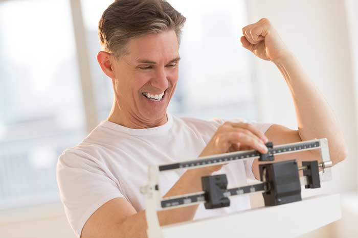 man excited about weight loss